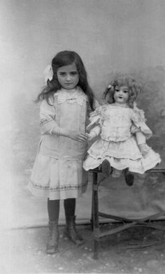 """1914 -1918 Little girl and her doll all """"dolled up"""" in cute dresses. Inspiration for heirloom sewers."""