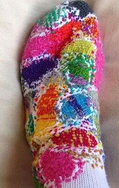 sock embroidery by celia pym. Looks great, but not sure how un/comfortable it would be? Maybe a better idea for slipper socks with soft socks worn under?