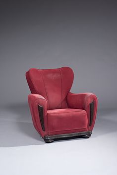 André groult (1884-1966) bergère à haut dossier, garniture de tissu rouge, montants et piètement en bois teinté estampille « a. groult » hauteur : 90 cm - largeur : 92 cm profondeur : 86 cm
