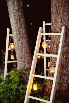 old ladders with hanging votives/lanterns