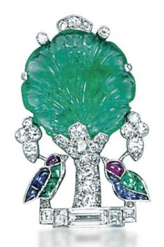 AN ART DECO MULTI-GEM AND DIAMOND BROOCH, BY CARTIER. Designed as two buff-top cabochon sapphire, emerald and ruby birds under a carved emerald tree with diamond detail, trunk and base, 1920s, 3.5 cm, with French assay mark for platinum. Signed Cartier Paris, numbered.
