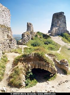 A summer view of partially ruined interior and entrance to the catacombs of famous Castle of Cachtice. This castle is situated in the mountains above the Cachtice village, Trencin region, Slovakia. The Castle of Cachtice was residence of the world famous Elizabeth Bathory and it is definitely worth a visit.