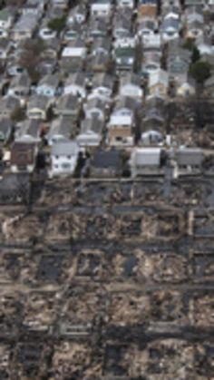 Burnt houses are seen next to those which survived in Breezy Point, a neighborhood located in the New York City borough of Queens, after it was devastated by Hurricane Sandy October 31, 2012. New York City and the sodden U.S. Northeast began an arduous journey back to normal on Wednesday after mammoth storm Sandy killed at least 64 people in a rampage that swamped coastal cities and cut power to millions.   REUTERS/Adrees Latif  (UNITED STATES - Tags: ENVIRONMENT DISASTER) via…