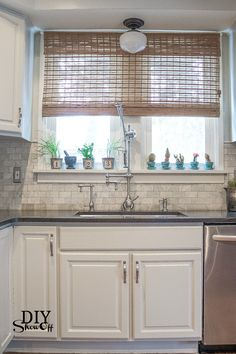 painted cabinets.  love the hardware, marble subway backsplash, dark grey counters.