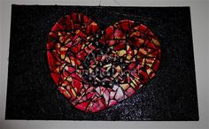 Healing Heart  Artist: Christie Noel  Recycled board, granulated mediu, recycled broken plate, marbles, and copper wire