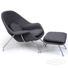 Womb Chair Ottoman, Carbonite Houndstooth Twill. Finnish Modern Furniture Designer Eero Saarinen created the Womb Chair, originally known as the Wombat Chair in 1948. He believed strongly that the whole field of design is all one body.