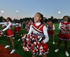 The Dorchester cheerleaders led a large crowd in rooting on the Dorchester football team during their first-ever home football game at Roberts Field on Friday night. Dorchester lost to Latin Academy 24-10. (Josh Reynolds / For the Boston Globe)