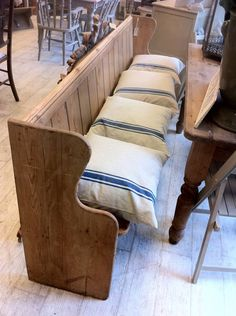 LOVE this old church pew as bench. I'm going to have to have Nate keep an eye out for one.