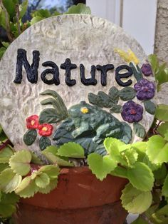 Handcrafted round cement frog/nature multicolored garden/yard art wall plaque