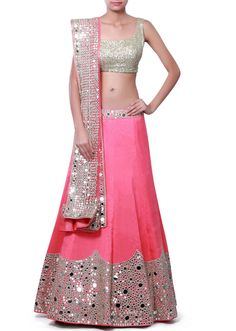 Pink unstitched lehenga featuring in silk.  Its embellished in mirror and zari embroidery.  Blouse is unstitched in green raw silk and dupatta in pink net.  Slight variation in color is possible.  95% of our customers believe that the product is as shown on the website.