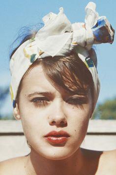 Bandana, poppy tinted lips and a moody stare.