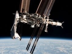 via APOD: 2014 August 31 - Space Shuttle and Space Station Photographed Together