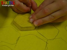 Use a pattern block to trace a bee hive.
