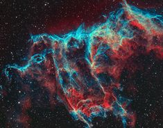 The Veil Nebula is a large supernova remnant, the expanding debris cloud from the death explosion of a massive star.