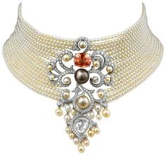 From Cartier's Secrets et Merveilles collection: Necklace made of platinum with a cushion-cut orange sapphire, fine pearls, a rose-cut diamond and brilliant-cut diamonds.