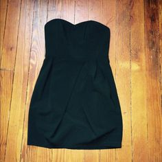 alythea black cocktail dress ADORABLE black strapless cocktail dress. The bottom has a cute criss cross bottom type thing? Not sure what to call it. I bought this off line and it's just the tiniest bit too short for me (I'm 5'4). I really love it and wish I could shrink for it! Anthropologie Dresses
