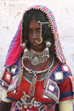 India - Andhra Pradesh | 'A visit to the Lambadi or Banjara tribal people at Raikal village. Amongst the many tribes who have thronged various places of eastern India, the Banjara are significant. They are the typical nomads and are known for their very colourful clothes' |  Image and caption © Walter Callens
