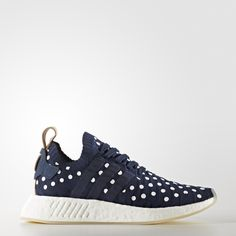 Inspiration comes from sources throughout the adidas archives. These women's shoes boast remixed vintage details and tech innovations for a bold streetwear statement. These shoes feature a playful polka-dot pattern on an indigo blue adidas Primeknit upper. The soft, flexible fabric provides a snug fit for all-day urban adventures. Sleek suede accents make them chic and ready for the streets.