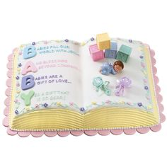 Celebrate the new little one in your life with this precious Letter Perfect Baby Shower Cake. Great for a new little girl or baby boy, shower cakes like this one are a great way to welcome a new life into your family. You could even add a candle to this cake and use it for baby's first birthday. Shaped like an open book and decorated with words of love and adoration, this baby shower cake is a wonderful way to celebrate the start of a new and exciting chapter.