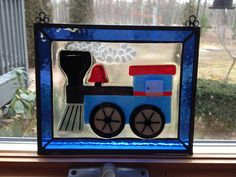 Baby shower gift fused train panel with a stained glass border