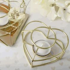 Love Themed Gold Wire Tealight Holder- These stunning gold love themed tealight candle holders are perfect for a modern romantic event. They will add a sensational finishing touch to your tables and also make exquisite favors for guests to take home. Candle Favors, Tealight Candle Holders, Votive Candles, White Candles, Tea Light Candles, Tea Lights, Engagement Party Favors, Engagement Gifts, Clear Gift Boxes