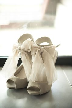 Here's a pair on Smart Bride - brand new and never worn, these size shoes have bows on the front and back! Available for $150.