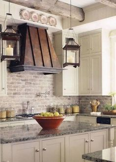 Rustic French Country Kitchen design ideas and decor with big island, beamed ceiling and brick tile back splash. Copper Kitchen Decor, Kitchen Redo, New Kitchen, Kitchen Remodel, Kitchen Ideas, Kitchen Rustic, Kitchen Lighting, Kitchen Island, Wall Lighting