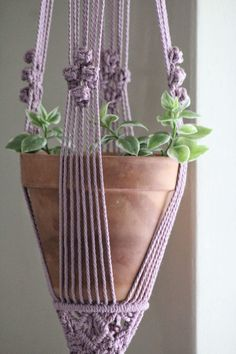 Primrose pink macrame plant hanger made with natural cotton rope. Lovely boho decor or natural interior design. Macrame Plant Hanger Patterns, Macrame Patterns, Macrame Owl, Macrame Knots, Art Macramé, Macrame Hanging Planter, Macrame Design, Macrame Projects, Indoor Plant Hangers