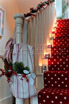 I LOVE the polka dot carpet runner! I would totally have a red polka dot carpet on my stairs year round if I could.