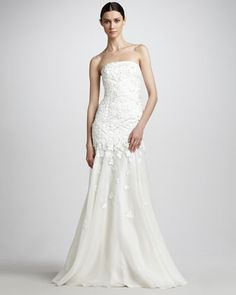 Floral-Applique Strapless Gown, Carmen Marc Valvo:  Soft chiffon and floral applique create a dreamy evening look on this Carmen Marc Valvo gown. Ivory mesh top with floral applique and tonal chiffon skirt. Straight, strapless neckline.