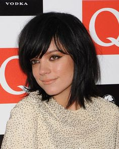 Lily Allen, layered with bangs.