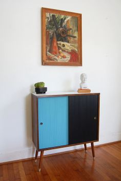 mid century modern cabinet with black and blue sliding doors Modern Cabinets, Sliding Doors, Cabinet, Furniture, Mid Century Modern Cabinets, Modern, Home Decor, Media Storage, Record Cabinet