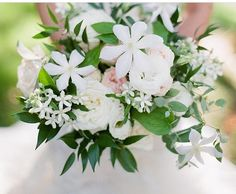 Fresh white Clematis & loose spring blossoms. Photo by  Kelli Durham Bouquet by Cody Floral Design