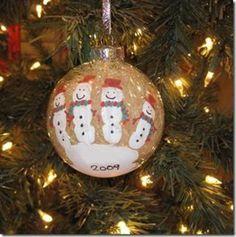 handprint snowmen on clear ornaments then fill...