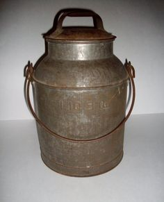fabulous old milk can...used to be part of my farmhouse decor
