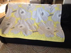 """Marimekko Blanket!  The retro-modern yellow and grey floral print is sure to please anyone.  Backed with turquoise fleece, this blanket measures 59""""x53.5"""" (nearly 22 square feet!)."""