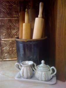 Rolling pins displayed in an old crock - might have to do this with the cool old rolling pins I have.