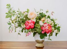 Lush and leafy asymmetric arrangement featuring peonies and garden roses | Photo by Christina McNeill