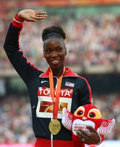 Tianna Bartoletta of the United States poses on the podium during the medal ceremony for the Women's Long Jump final during day eight of the 15th IAAF World Athletics Championships Beijing 2015 at Beijing National Stadium