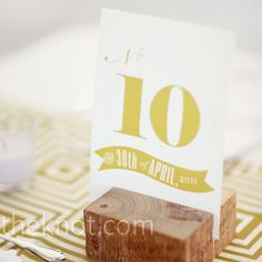 Vintage-inspired fonts were printed on white cardstock and placed in a block of wood to carry on the elegant farm vibe. (From TheKnot.com)