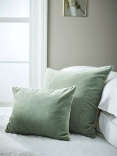 Velvet & Linen Cushions - Sage Fronted in luxuriously soft velvet with a natural colour linen reverse and three mother-of-pearl buttons, our bestselling velvet & linen cushions are available in either a rectangular or a large square shape. Each cushion c Green Cushions, Green Throw Pillows, Bed Cushions, Velvet Cushions, Sage Green Bedroom, Green Bedroom Decor, Green Rooms, Ikea, Bedroom Decor
