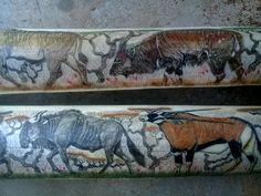 Scrimshawed giraffe bones by Alfred Dube.