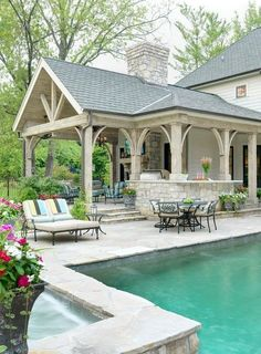 Gorgeous pool, stone work and patio. Kitchen idea with pergola above (attached to patio) Pool house by Mitchell Wall Architecture Perfection!