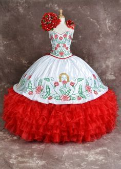 Made for a princess! This beautiful quinceanera dress with red roses is perfect for a charra or western theme with it's beautiful white with red roses charra dress is stylish and elegant. It will look fabulous for your quinceanera.