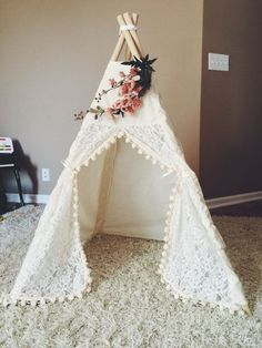 The Itty Bitty teepee is so CUTE! Perfect for babies, small toddlers, dogs and cats. The poles are included! The poles are 48 inches long. They are secured together with thick rope to ensure durability. The teepee stands a little over 3 feet tall and is 30 by 30. It can be folded up like an umbrella and transferred to different areas (or even outside! but be sure to bring it inside after use). **FLORAL TOPPER SOLD SEPARATELY! Not included with the price of teepee