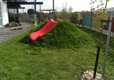 Slide mound. I wonder if we could incorporate a slide into our natural slope? Great for waterplay in the hot months, too!