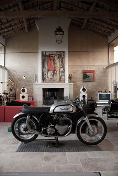 I've always pictured motorbike in the middle if a loft space ... Haven't a clue why