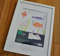 Want this kid art display from Target! Matted frame where the front opens for frequent changes (while still hanging on the wall) and has storage space within for keeping old kid art or older photos. Love it.
