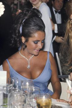 "Her decolletage was upstaged only by a stunning 69-carat Cartier diamond around her neck, a gift from then-husband Burton. It was originally bought as a ring, but the star said, ""even for me it was too big, so we had Cartier design a necklace."""