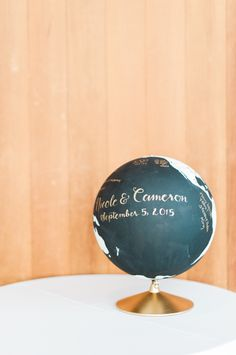 DIY painted globe guest book: http://www.stylemepretty.com/oregon-weddings/bend/2015/11/13/hopelessly-elegant-black-white-gold-outdoor-oregon-wedding/ | Photography: Brittany Lauren - http://brittanylauren.net/